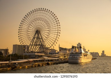 Osaka, Japan - October 18, 2018: A cruise ship with Tempozan Giant Ferris Wheel at the Tempozan Harbor Village.