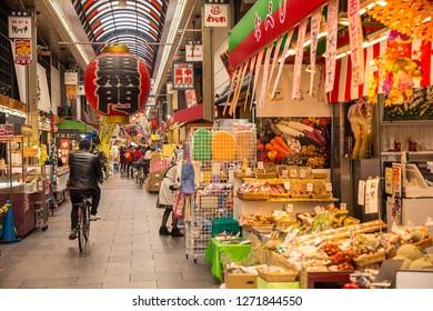 Osaka, Japan - October 21, 2018: The Kuromon Ichiba is a spacious market with vendors selling street food, fresh produce and shellfish, plus souvenirs.