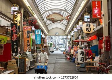 Osaka, Japan - October 22, 2018: The Kuromon Ichiba is a spacious market with vendors selling street food, fresh produce and shellfish, plus souvenirs.
