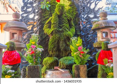 Osaka, Japan - October 28 2018: Hozenji Temple  is a small temple in Dotonbori and Namba area, famous for Fudo Myo-o, a Buddhist spirit which completely covered in lush green moss