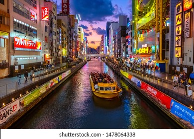 Osaka, Japan - October 28 2018: Dotonbori is one of the most popular tourist destination runs alongside Dotonbori canal between Dotonboribashi and Nipponbashi in the Namba ward