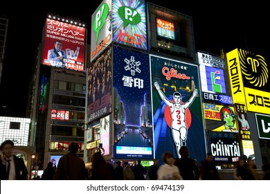 OSAKA, JAPAN - OCTOBER 28: The famous Glico Man billboard and other neon displays in Dotonbori on October 28, 2010 in Osaka, Japan. Dotonbori is a popular entertainment district for tourists.