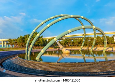 Osaka, Japan - October 29 2018: Rinku Park situated on the other side of Kansai international airport, it's the best spot to see flying airplane from the airport and the evening sun