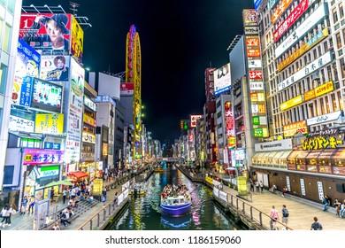 Osaka, Japan - Sep 20th 2018 - Shoppings, stores and a touristic boat in Osaka downtown, near Ebisu bridge, Osaka Japan