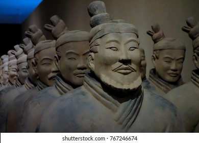 OSAKA, JAPAN - September 02, 2016: Replica of a terracotta infantryman from the funerary army of of a Chinese Emperor over white in The national museum of art,Osaka