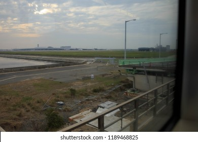 Osaka, Japan - September 24, 2018: View outside train window of typhoon damaged on-ramp to bridge connecting Kansai International Airport to the mainland