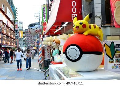 OSAKA, JAPAN - SEPTEMBER 25 2016: Big Pokemon Ball and Pikachu display at the gift shop in Shinsekai district