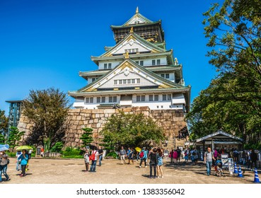 Osaka, Japan - September 28, 2018: Tourist and people visit the Osaka castle in Osaka, Japan. It is the famous landmark and popular tourist destination of Osaka.