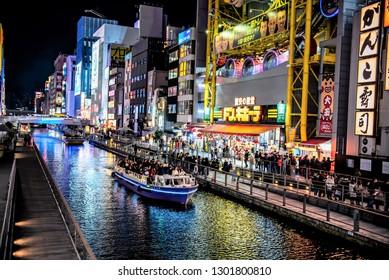 OSAKA, JAPAN-DECEMBER 28, 2018: Dotonbori's one of the principal tourist destinations in Osaka, Japan. Canal from Dotonbori bridge to Nipponbashi bridge, a popular nightlife and entertainment area.