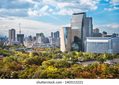 Osaka, Japan-November 1, 2018: View from Osaka Castle with the Castle Park in autumn and Osaka Museum of History, NHK Broadcasting building and Police Department Building in the background.