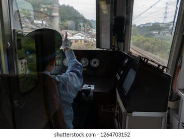 OSAKA, JAPAN-NOVEMBER 12, 2018: Unidentified train driver points at warning lights in Osaka, Japan.