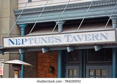 OSAKA, JP - APR. 7: New York theme Neptune's tavern wooden signage on April 7, 2017 in Universal Studios, Osaka, Japan. Universal Studios Japan is a theme park located in Konohana-ku, Osaka, Japan.