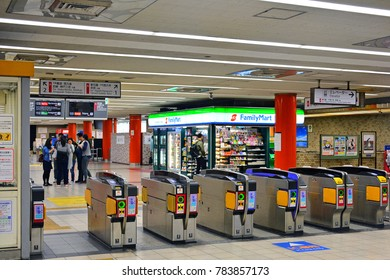 OSAKA, JP - APR. 9: Family Mart convenient store facade at subway on April 9, 2017 in Osaka, Japan. Family Mart is a Japanese-owned convenience store chain and currently operates over 18,000 stores.