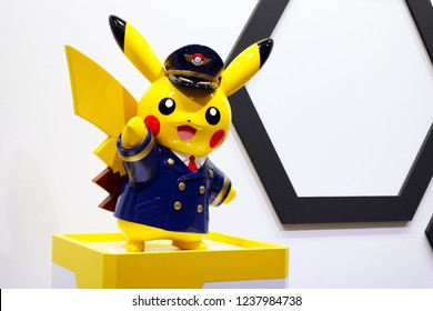 Osaka, JP - JULY 29, 2018: The yellow plastic model of airport staff suit monster characters in Pokemon animation that showing in Kansai International Airport.