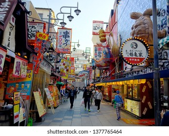 Osaka, Kansai, Japan - 18th October 2018 : View of the main road in the food and eatery district of Shinsekai area in Osaka, Japan