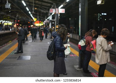 Osaka - Nov. 15, 2018: Japanese are seen reading at train platform in JR Namba Station