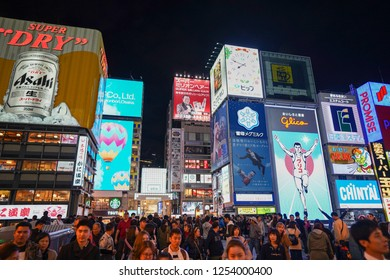 Osaka - Nov. 15, 2018: Tourists are seen sight seeing at famous spot in Dotonbori, Namba with Glico man billboard