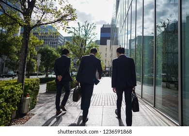Osaka - Nov. 15, 2018: Unidentified office workers are seen walking towards Umeda Station