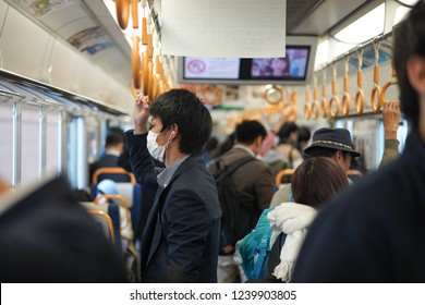 Osaka - Nov. 15, 2018: Unidentified passenger is seen wearing mask inside train bound for Tennoji Station