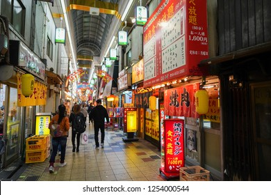 Osaka - Nov. 15, 2018: Visitors are seen walking at Janjan Yokocho street located in Shinsekai