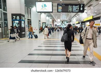 Osaka - Nov. 16, 2018: Japanese commuters are seen walking inside of Osaka Station