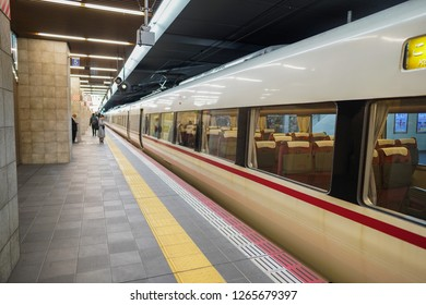Osaka - Nov. 16, 2018: Japanese commuters are seen waiting for train at Osaka Station