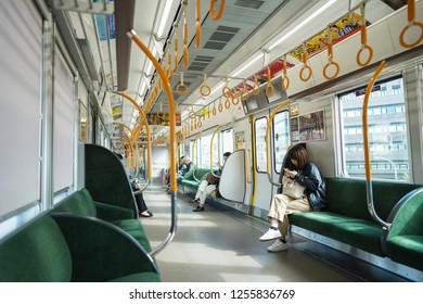 Osaka - Nov. 16, 2018: Passengers riding a train bound for Osaka Station on JR Osaka Outer loop line