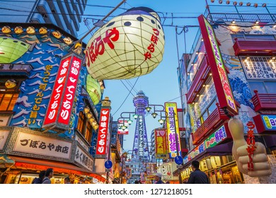 Osaka - Nov. 17, 2018: Blowfish and Tsutenkaku Tower in the background at Shinsekai