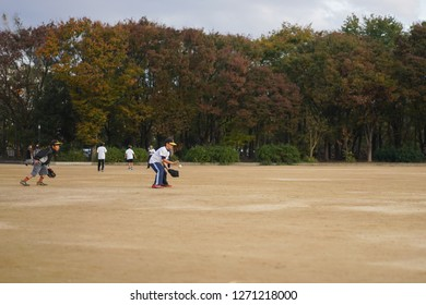 Osaka - Nov. 17, 2018: Junior high school students are seen playing baseball at Osaka Public Park