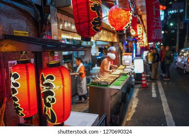 Osaka - Nov. 17, 2018: Selective focus on signboard of Japanese food at back alley of Dotonbori