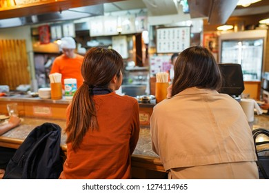 Osaka - Nov. 17, 2018: Unidentified Japanese are seen having meal at local Izakaya or pub in Dotonbori