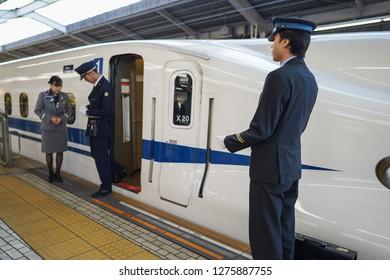 Osaka - Nov. 18, 2018: Shinkansen train staff is seen greeting at Shin-Osaka Station