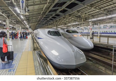 OSAKA - NOV,10 : A Shinkansen train pulls into Shin Osaka Station that  Passengers board the Shinkansen bullet train . All trains stop at Tokyo, Yokohama, Nagoya, Kyoto, and Osaka.JAPAN NOV 10,2015