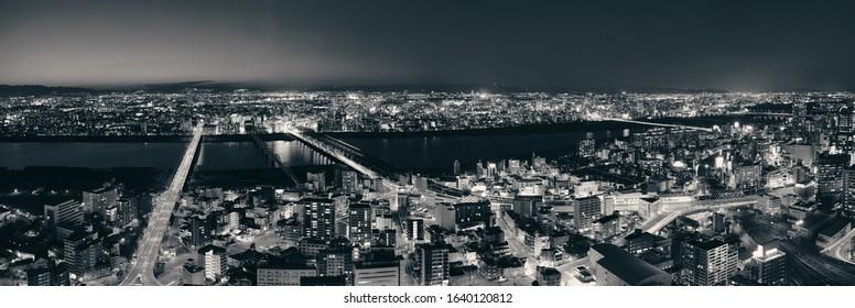 Osaka urban city at night rooftop panoramic view. Japan.