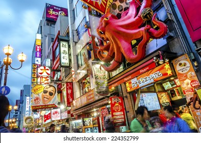 OSAKA,JAPAN - 18 April,2014 :The famous Tagoyaki shop in Dotonbori , a popular nightlife and entertainment area characterized by its eccentric atmosphere and large illuminated signboards.