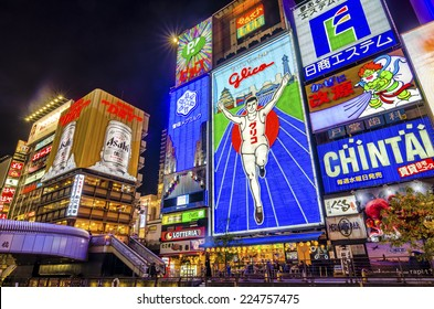 OSAKA,JAPAN - 18 April,2014 :The famous Glico man neon sign in Dotonbori , a popular nightlife and entertainment area characterized by its eccentric atmosphere and large illuminated signboards.