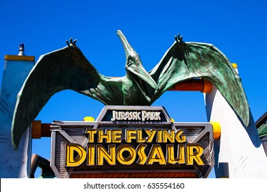 Osaka,JAPAN - APR 26, 2017 :Sign of the Flying DINOSAUR station and Pteranodon figure at Universal Studios Japan.Flying DINOSAUR of the famous attractions in Universal Studios JAPAN.