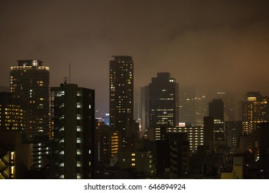 OSAKA,JAPAN - DECEMBER 1, 2016: The skyscrapers in misty night time in Osaka.