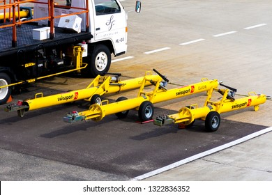 Osaka/Japan - Feb 25 2019: Tow bars of Swissport Japan. It is one of the providers of ground handling services in Kansai International Airport (KIX).
