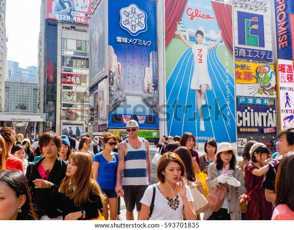 Osaka,Japan - October 27, 2014 : For a limited time only, the actress Haruka Ayase will be pictured on the giant Glico signboard, the symbol of Osaka Dotonbori.