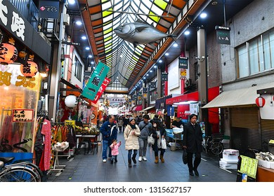 Osaka,Japan-02 14 2018:People walking in a  shotengai which is a kind of indoor shopping mall crossed with an outdoor market, not as chaotic as a market but not as generic as a mall.