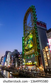 OSAKA,JAPAN-APRIL 15 : Dotonbori facade on April,15,2018 in Osaka,Japan.It's a popular nightlife and entertainment area characterized by eccentric atmosphere and large illuminated signboards.