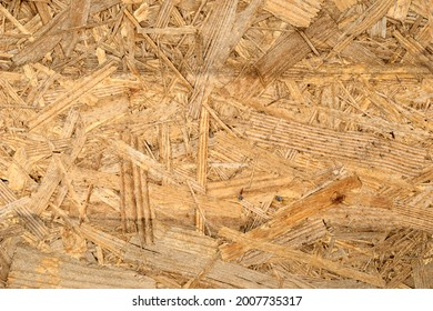 OSB board texture. Brown wooden background. Simple pressed chipboard pattern. Chip board background. Brown wood texture. High quality photo