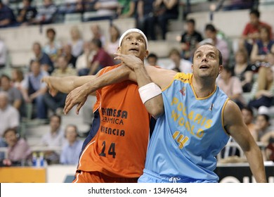 Oscar Garcia and Ruben Garces looking for a rebound