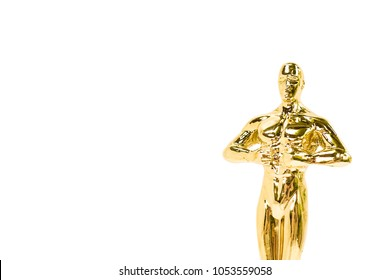 Oscars golden award or trophy isolated on a white background. Success and victory concept. Copy space on the left area for your text.