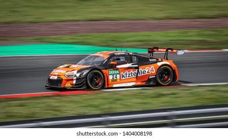 Oschersleben, Germany, April 28, 2019: Audi R8 LMS GT4 of BWT Mucke Motorsport driven by Mike Ortmann competes during Adac GT Master at Motorsport Arena Oschersleben.