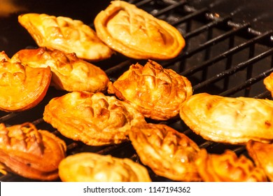 Oscypek - traditional smoked cheese made of salted sheep milk on a grill. Traditional Polish smoked cheese made of sheep milk known as oscypek on barbecue