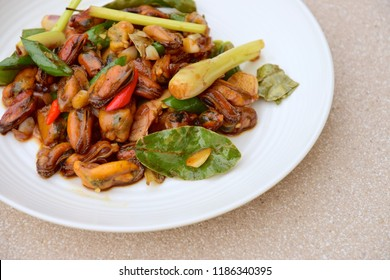 Oseng Tumis Kerang, Indonesian food. Stir-fried mussels with soy sauce, lemongrass, bayleaf, ginger, garlic and chili.