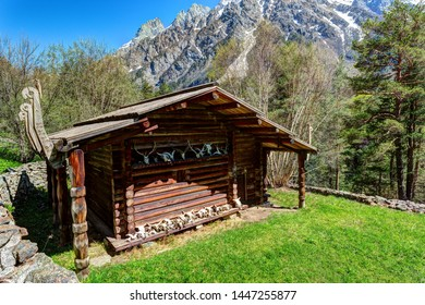 OSETIAN SACRED ALTAR - 16 MAY 2019: Wooden hut - sacred altar deep in mountains. Tsei gorge, Russia.