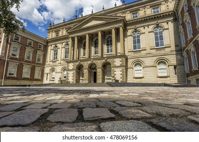Osgoode Hall in downtown Toronto shown with its cobblestone walkway.